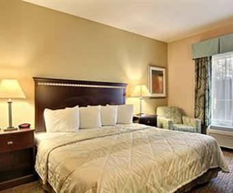 Magnolia Inn & Suites Room Photos