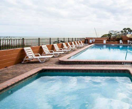 Outdoor Swimming Pool of Quality Inn & Suites On The Beach