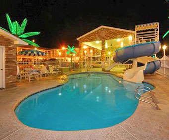 Outdoor Pool at Rodeway Inn And Suites