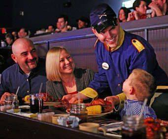 Dixie Stampede Host Talking with Guests
