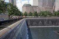 Wonder at the serene twin reflecting pools of the 9/11 Memorial